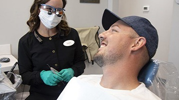 Hygienist smiling with a patient