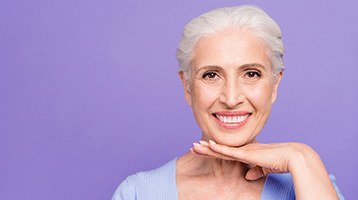 An older woman with dental implants in Longmont smiling