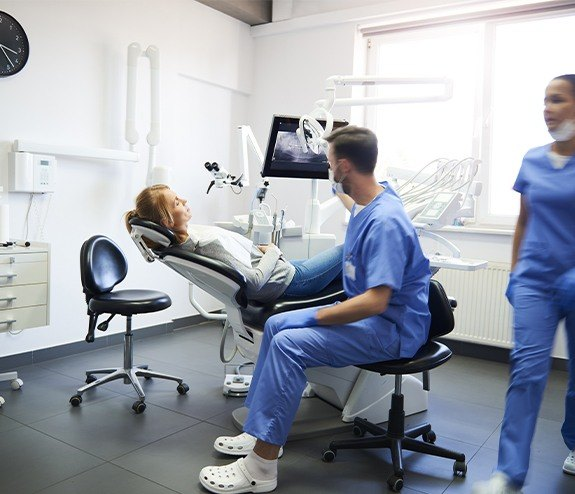 Dentist talking to patient before root canal therapy