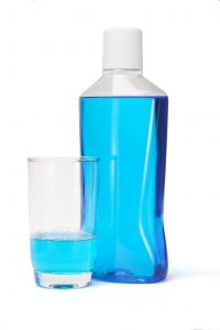 bottle of blue mouthwash white cap