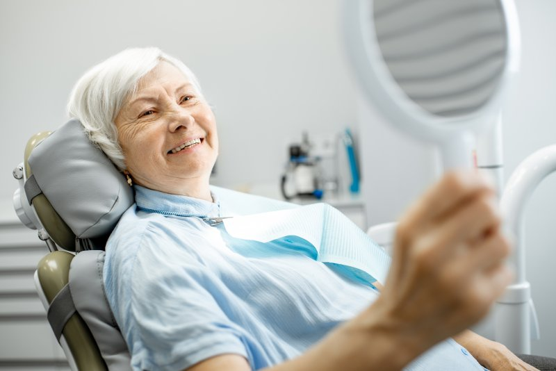 an older woman in the dentist chair