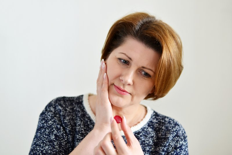 Woman Rubbing Jaw