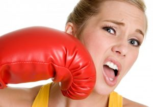 woman getting punched in face with boxing glove