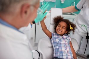 little girl high-fiving her dentist